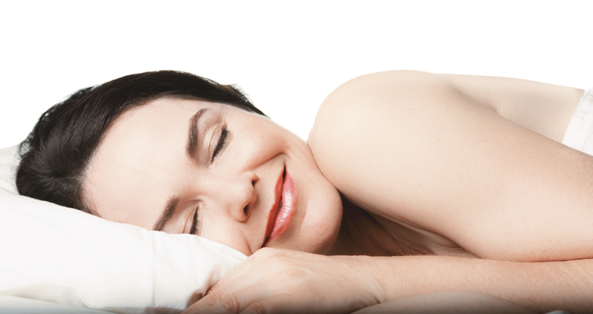 Woman with night guard sleeps peacefully